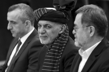 Afghan President Ashraf Ghani, surrounded by candidates Amrullah Saleh (L) and Sarwar Danish (R).